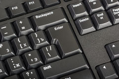 Electronic collection - black computer keyboard with key enter Royalty Free Stock Photos