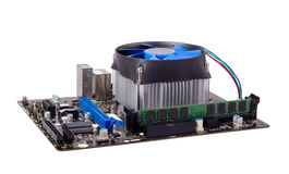 Electronic collection - Computer motherboard with CPU cooler Stock Image