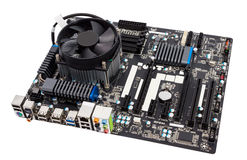 Electronic collection - Computer motherboard with CPU cooler stock photography