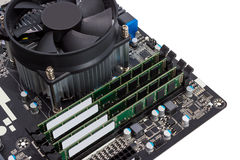 Electronic collection - Computer motherboard with CPU cooler Stock Images