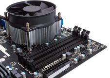 Electronic collection - Computer motherboard with CPU cooler Stock Photos