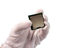 Electronic collection - CPU in hand isolated on white background. Electronic collection - Hand holds computer CPU processor chip from the top side isolated on Stock Images