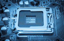 Electronic collection - Empty CPU socket toned blue Stock Images