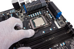 Electronic collection - Installation of processor Royalty Free Stock Photos