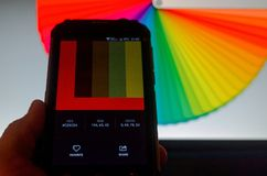 Electronic color palettes between a smartphone and a laptop. stock photography