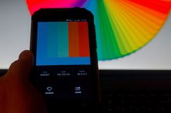 Electronic color palettes between a smartphone and a laptop. Brest, Belarus - April 15, 2019: Electronic color palettes between a smartphone and a laptop royalty free stock photo