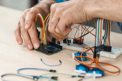 Electronic component connected with breadboard. In laboratory. electrical engineering with cables and controller. Modern technologies, electronics, diy product stock photography