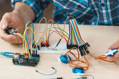 Electronic component connected with breadboard. In laboratory. electrical engineering with cables and controller. Modern technologies, electronics, diy product Royalty Free Stock Images