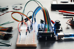 Electronic component connected with breadboard. In laboratory. Electrical engineering with led and microcontroller on programmer workplace. Hacker conduct Royalty Free Stock Photos