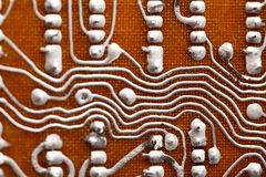 Electronic component vintage design. Brown circuit board and soldering traces macro view. Shallow depth of field photo Stock Photo