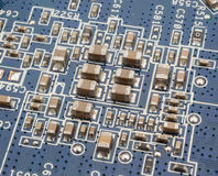 Electronic components. On the circuit board Stock Photos