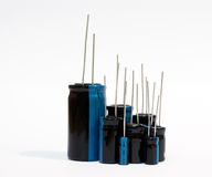 Electronic components - electrolytic capacitor. Electronic components - a set of electrolytic capacitors on white background stock image