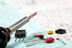 Electronic components and iron on electric schemes Stock Photo