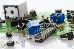 Electronic components on the motherboard with 10 local code lock. Switches, resistors. transistors and connectors on the motherboard with 10 local code lock Stock Photo