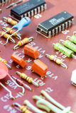 Electronic components on a obsolete printed-circuit board Stock Photography