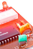 Electronic components on a obsolete printed-circuit board. Close up of electronic components on a obsolete printed-circuit board Stock Images