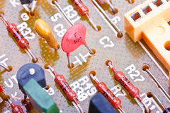 Electronic components on a printed-circuit board. Close up of electronic components on a obsolete printed-circuit board Royalty Free Stock Photography