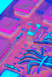 Electronic components on a printed-circuit board background Royalty Free Stock Images