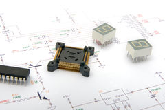 Electronic components on schematic drawings. In the baclground Royalty Free Stock Photo