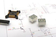 Electronic components on schematics Stock Images