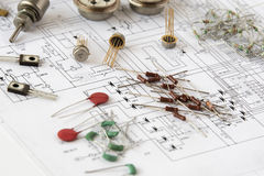 Electronic components. Some electronic components on a printed circuit scheme royalty free stock photo