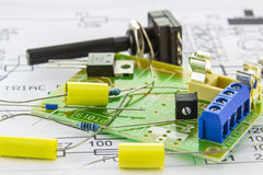 Electronic components for triac controller on the motherboard. Electronic components for triac controller with motherboard ready for assembly according to the Royalty Free Stock Images