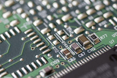 Electronic compontents. Closeup of a printed circuit board with components such as integrated circuits Royalty Free Stock Photo