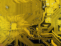 Electronic computer circuit board. Electronic computer board with gold traces Stock Photo