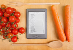 Electronic Cookbook in the Kitchen Royalty Free Stock Photos
