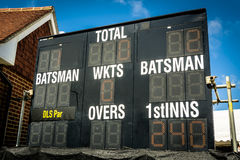 Electronic cricket scoreboard showing run chase in second innings. Scoreboard showing all the key numbers in sunshine at county match Stock Images