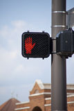 Electronic crosswalk sign with warning hand signal. royalty free stock photography