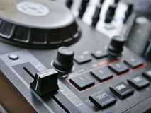 Electronic dance music digital audio dj gear with knobs, faders, at an edm festival. royalty free stock image
