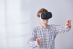 Electronic device on head. Happy boy with electronic device on head have fun in virtual reality stock photos