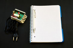 Electronic device with a notebook and a pen next to him Stock Image