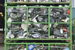 Electronic devices components waiting to be recycled in a container, on a recycling plant site. Pile of sorted electronic garbage.  stock photography