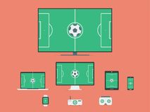 Electronic Devices with Football / Soccer Game On Screens. Green Field On Television Set, Desktop Computer, Laptop, Tablet, Mobile Stock Photo