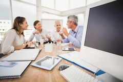 Electronic devices in front of talking business people Royalty Free Stock Image