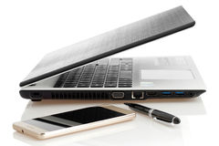 Electronic devices-notebook,mobile phone and ballpoint pen. Royalty Free Stock Image