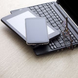 Electronic devices on wooden table Royalty Free Stock Photography