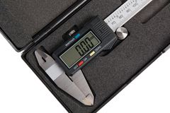Electronic digital caliper in box. New electronic digital caliper in plastic box on white background stock photography