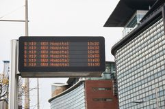 Electronic time schedule display at a typical bus stop. Electronic display at a bus stop in Glasgow City Centre showing time schedule for bus line X19 Stock Images