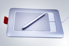 Electronic drawing pen tablet isolated. On blue background Royalty Free Stock Image
