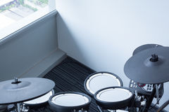 Electronic drum set in the room corner as musical background tec Stock Image