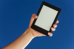 Electronic ebook in hand Stock Images
