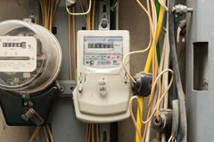 Electronic electric meter electricity company Royalty Free Stock Photos