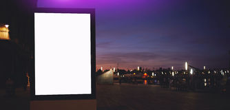 Electronic empty billboard with copy space for your text message or promotional content, public information board with night city Stock Photo