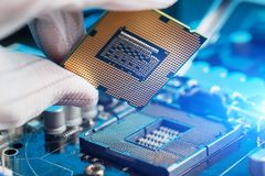 Electronic engineer of computer technology. Maintenance computer cpu hardware upgrade of motherboard component. Pc repair,. Technician and industry support stock photography