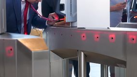 Electronic entrance gate where people can pass by scanning the bar code of a card or badge. Media. Building security