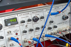 Electronic equipment console. The front control console of sophisticated electronic equipment used for scientific experiments with lasers Stock Photos