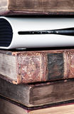 Electronic Equipment In A Pile Of Old Books Royalty Free Stock Photography
